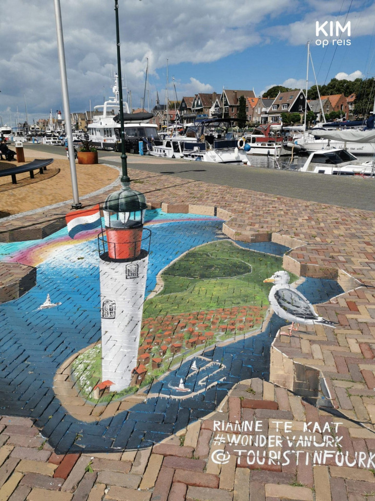 Miracle of Urk Graffiti - depicting the lighthouse on the island of Urk with a watching seagull Church by the Sea